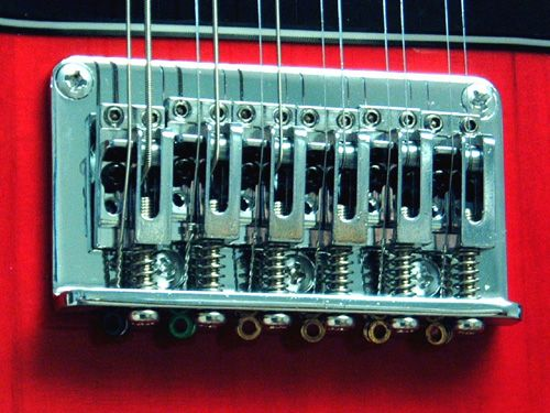 I don't think this guitar's intonation has been set up properly since both strings of each pair have the same length.