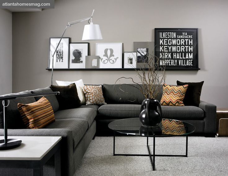 In the media room, pillows in silk, cotton and velvet sit pretty on the plush pepper-colored sectional. A metal picture rail displays a few pieces from the home's extensive collection of artwork, including an Eva Zeisel silkscreen and a vintage trolley sign.