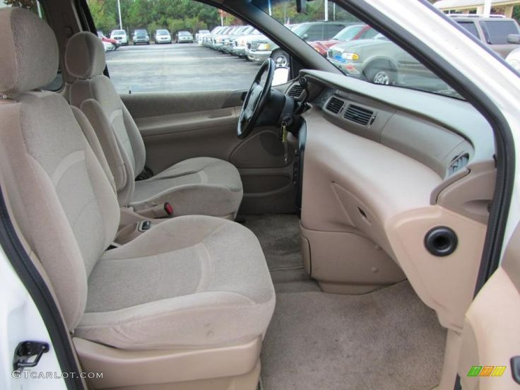 1998 Ford Windstar Limited interior with tan cloth and the Limited only tan center dash trim.