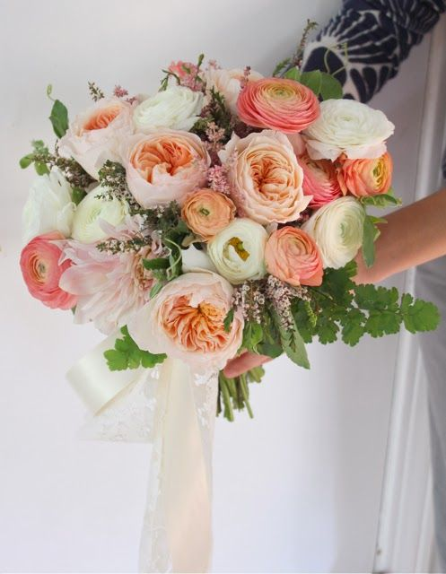 juliet garden roses, peach and coral ranunculus, ivory ranunculus, cafe au'lait dahlia, passionflower vine, astilbe, and maidenhair fern by sweet pea floral design