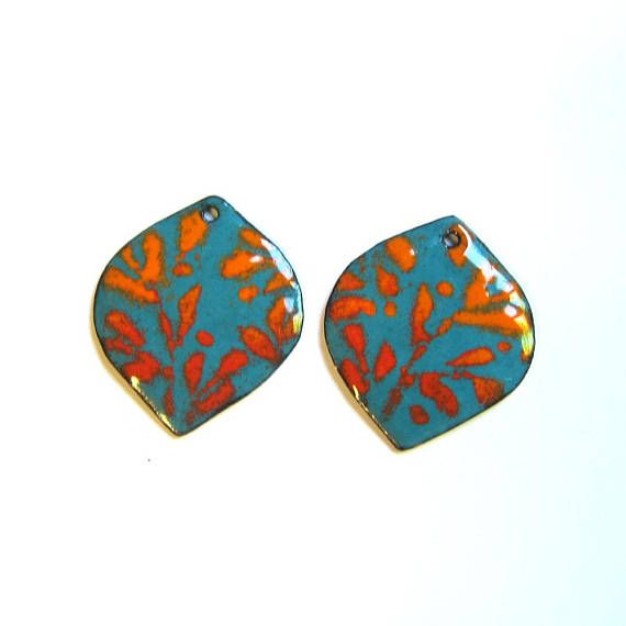 Petals are cut from copper sheet and hammered into shape before the enameling process begins. After a first firing of solid turquoise blue enamel a second firing is required for the red and orange vines. The backs are turquoise enamel. One hole is drilled in each petal drop. Unique, artistic and very colorful. This sale is for 2 handmade enamel components as shown in the pictures. c2615 Size: 25 mm x 22 mm wide (1 x 7/8) Vitreous enamel on copper Your cost of shipping is $3.00 for the ...