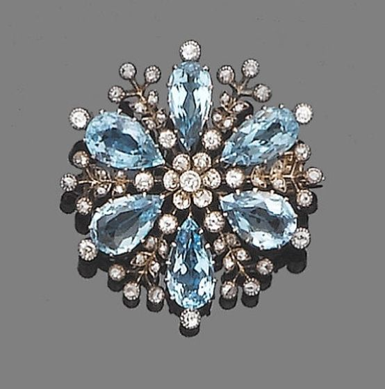 An aquamarine and diamond brooch, circa 1910 – stylised snowflake set with pear-shaped aquamarines