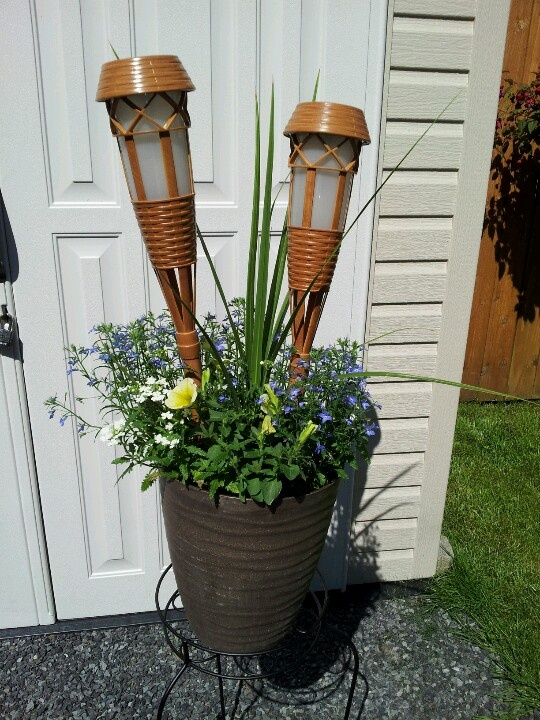 Bamboo solar lights in a flower pot! Inspired by a Lowes