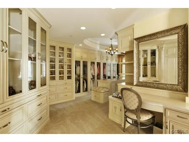 Amazing Walk In Closet With Vanity And Tons Of Shoe Space
