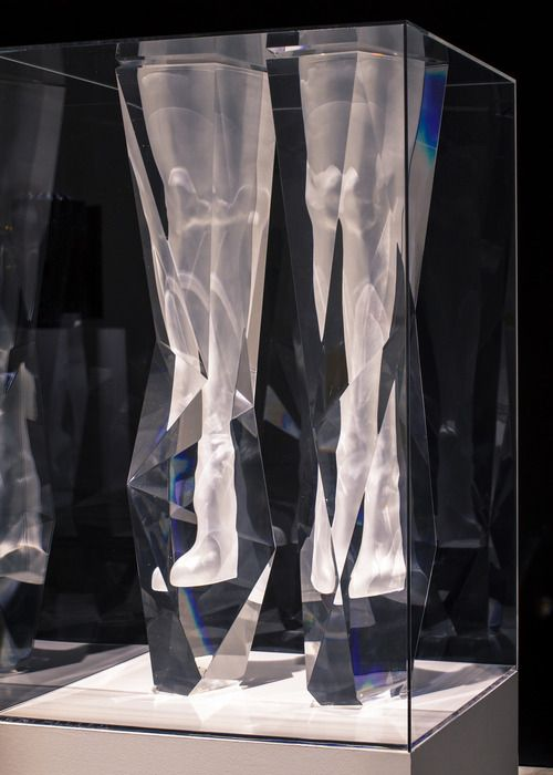 """This pair of crystal boots, titled """"the Frozen Boots"""" is displayed at the """"Image Makers"""" exhibition. It looks as though there was a pair of legs inside the crystal block but actually it is made as one seamless solid body. To create this piece, first the long leather boots I created were scanned using a 3D scanner."""