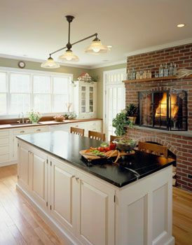 The Emmaline Gabrielle Farmhouse | Connor Homes Fireplace in the kitchen