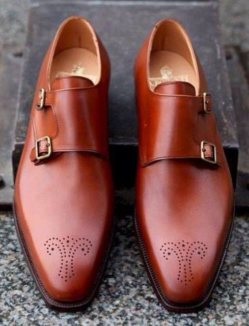 Toru Saito Bespoke Shoemaker/Got some Stacy Adams that look just like these except there at more patterns ok the front of the she or for probably a fraction of the cost of these!!! Lol