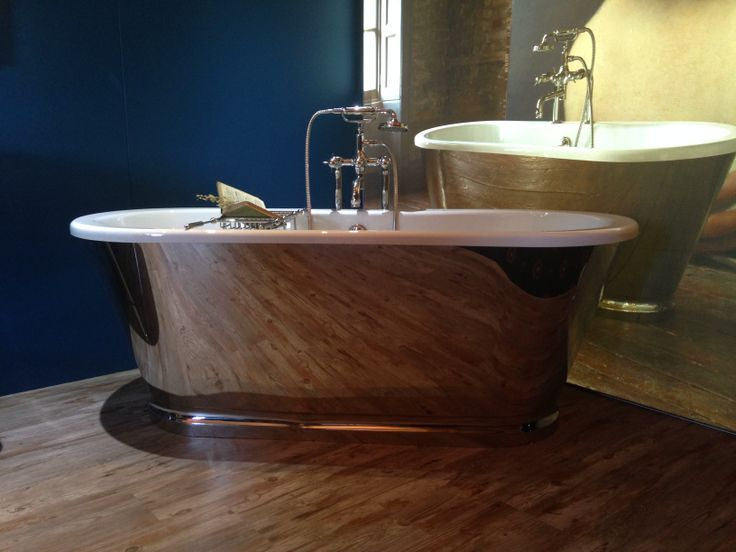 Albermarle freestanding bath with nickel finish stainless steel surround.