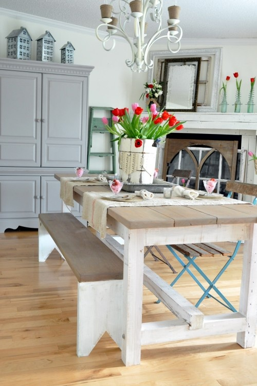fireplace check, farm table check, tulips in a cool bucket-love. this room is great