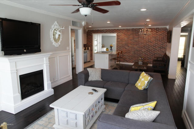 Living Room Set Up Flat Screen Above White Fireplace