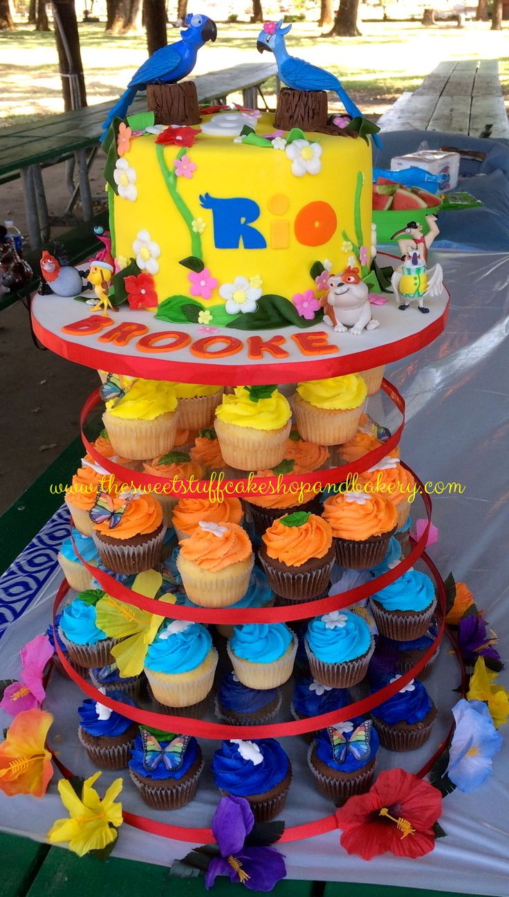 Super Colorful Rio Themed Cupcake Tower, With Birthday Cake on top.