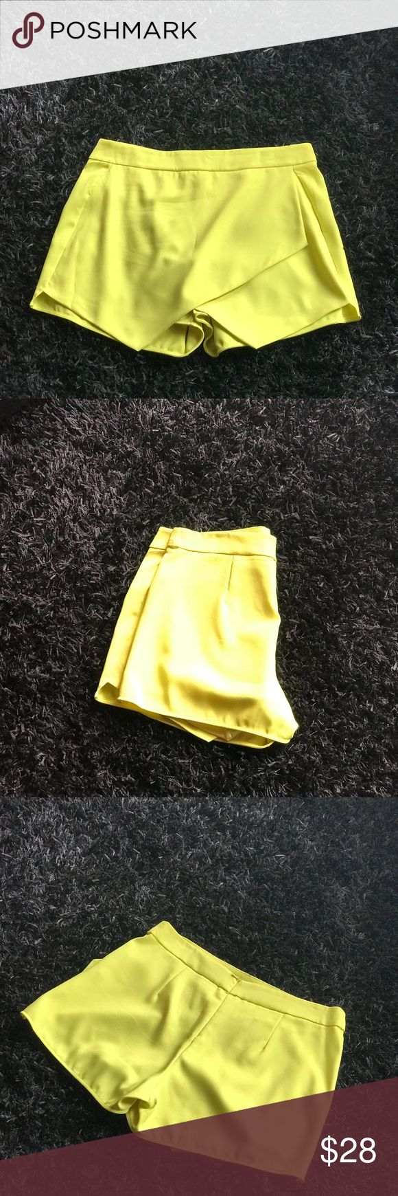 Asymmetric Skort Neon yellow Skort with an asymmetric split cut in the front that is super stylish. The back has the appearance of shorts while the front appears as a skirt 💛 Skirts Asymmetrical