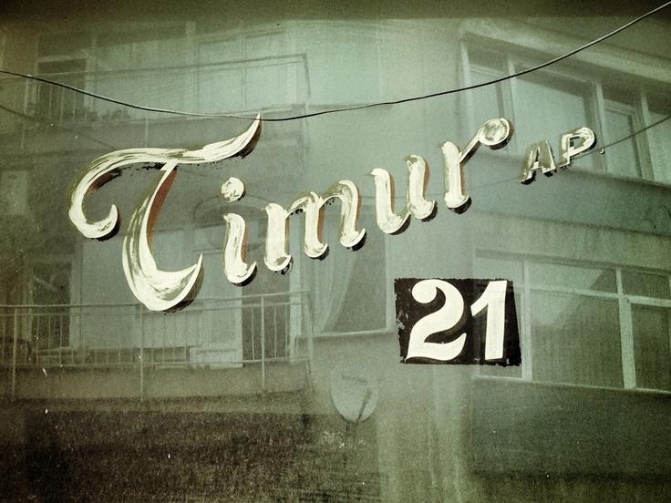 Timur, ap. 21. Kadıköy.  Hand painted house signs in Istanbul, Turkey.