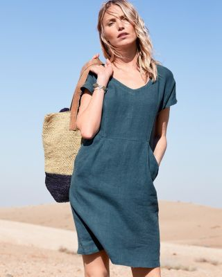 b78ceef0989 A classic T-shirt dress ups the relaxation factor in French linen. Designed  to flatter