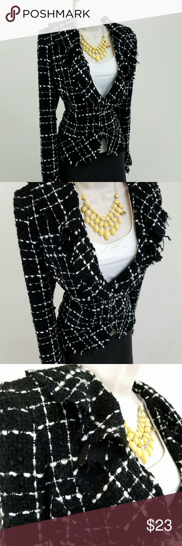 White House Black Market tweed jacket Black and white long-sleeved v-neck tweed jacket featuring waterfall ruffle with frayed edges, front hook-and-eye closure, and light shoulder pads.  Lined.  Bust 20.5 / waist 18.5 / length 22.5 inches.  100% acrylic.    Thanks for visiting my closet!  I add listings every week; come back soon & see what's new! White House Black Market Jackets & Coats