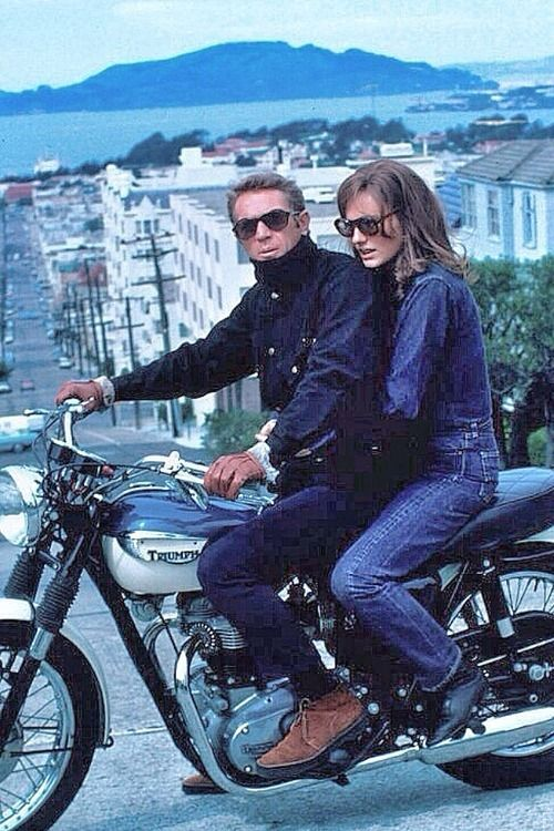 Steve McQueen and Jaqueline Bisset on a Thriuph motorcycle during the filming of Bullitt.