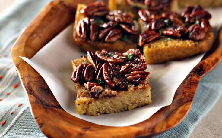 <p>To make these bars, polenta is cooked in coconut milk with maple syrup and orange juice. Fresh rosemary and thyme and a pinch of ground nutmeg help to round out the sweetness. </p>