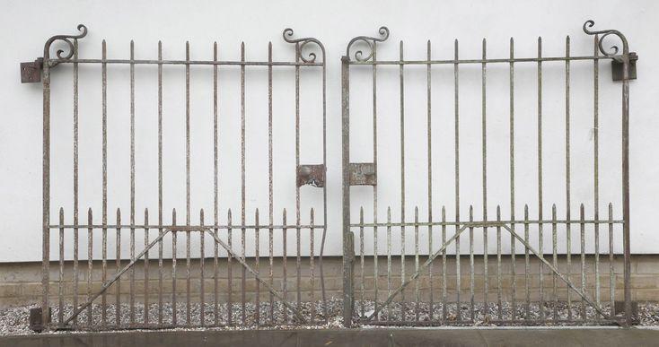 A pair of wrought iron gates,19th century,each gate 144cm wide x 164cm high (2)