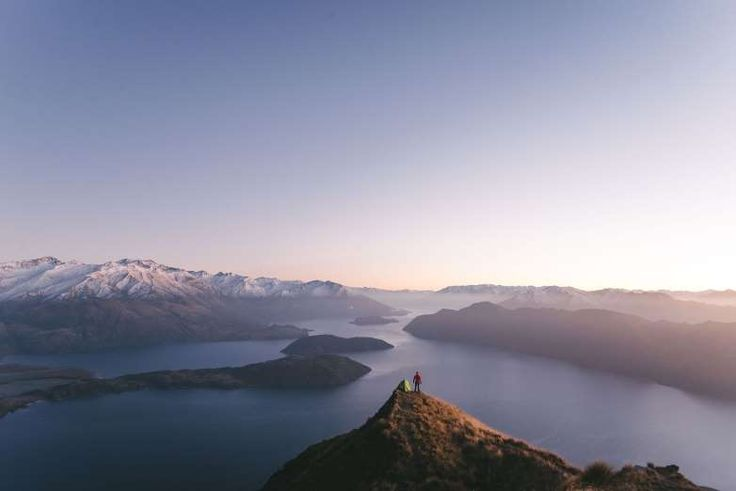 A man stands at Roys Peak, Wanaka, New Zealand --- Johan Lolos/Rex Features