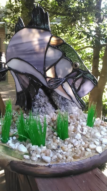 3d stained glass rock fish...mounted on a underwater setting, the eye is a fish eye from a taxidermy supply. The tail is curved and the side fins are perpendicular mounted.