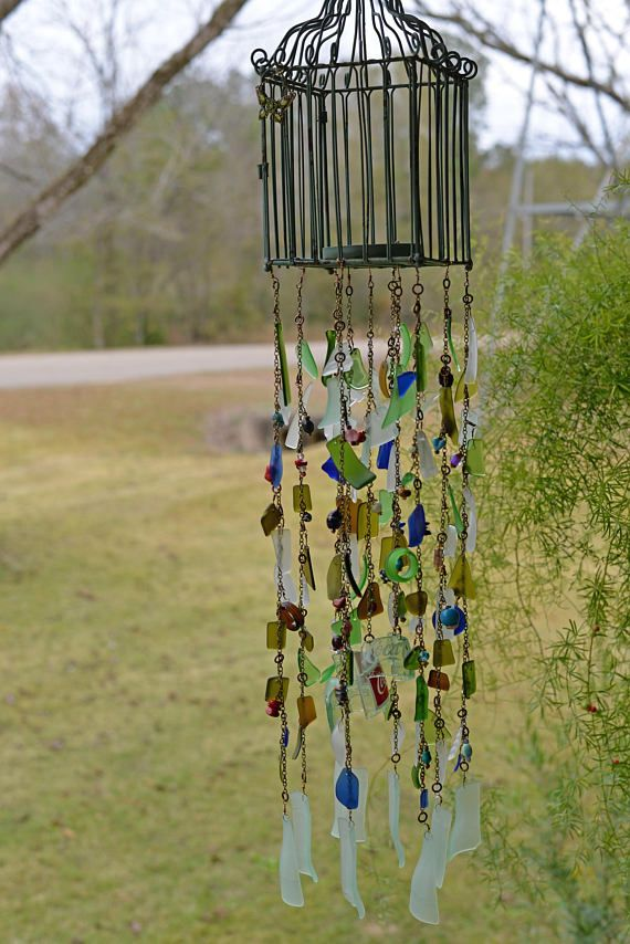 Free your spirit with this Bohemian style wind chime and sun catcher. Its a beautiful, one of a kind piece Ive made with glass beads, recycled wine bottles, sea glass and drift wood and Coca-cola bottles. It hangs approximately 2.5 feet in length and 5 wide. Pictures do not do