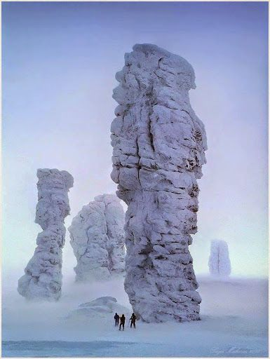 Manpupuner Rock Formations, Russia. The Manpupuner rock formations or the Seven Strong Men Rock Formations or Poles of the Komi Republic are a set of 7 gigantic abnormally shaped stone pillars located west of the Ural mountains in the Troitsko-Pechorsky District of the Komi Republic. These monoliths are around 30 to 42 m high and jut out of a hilly plateau formed through the weathering effects of ice and winds