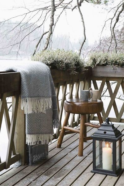 Lovely balcony for cosying up enjoying the outdoors in winter. Love this blanket.: