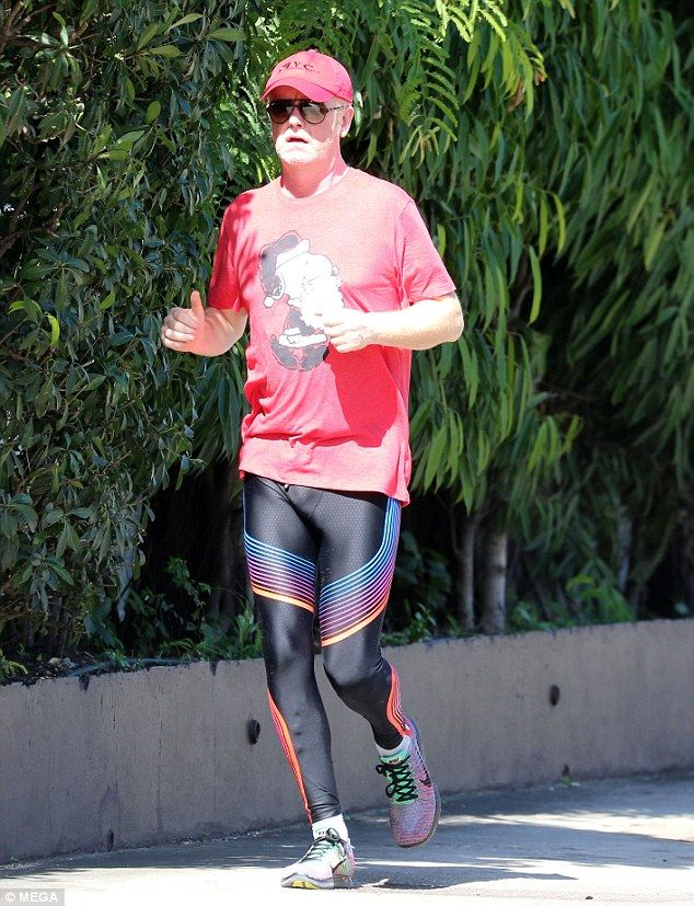 Yule jog! Chris Evans heads out for a jog on the first day of his post-Christmas trip to Barbados in bizarre ensemble of black lycra leggings and a Snoopy T-Shirt