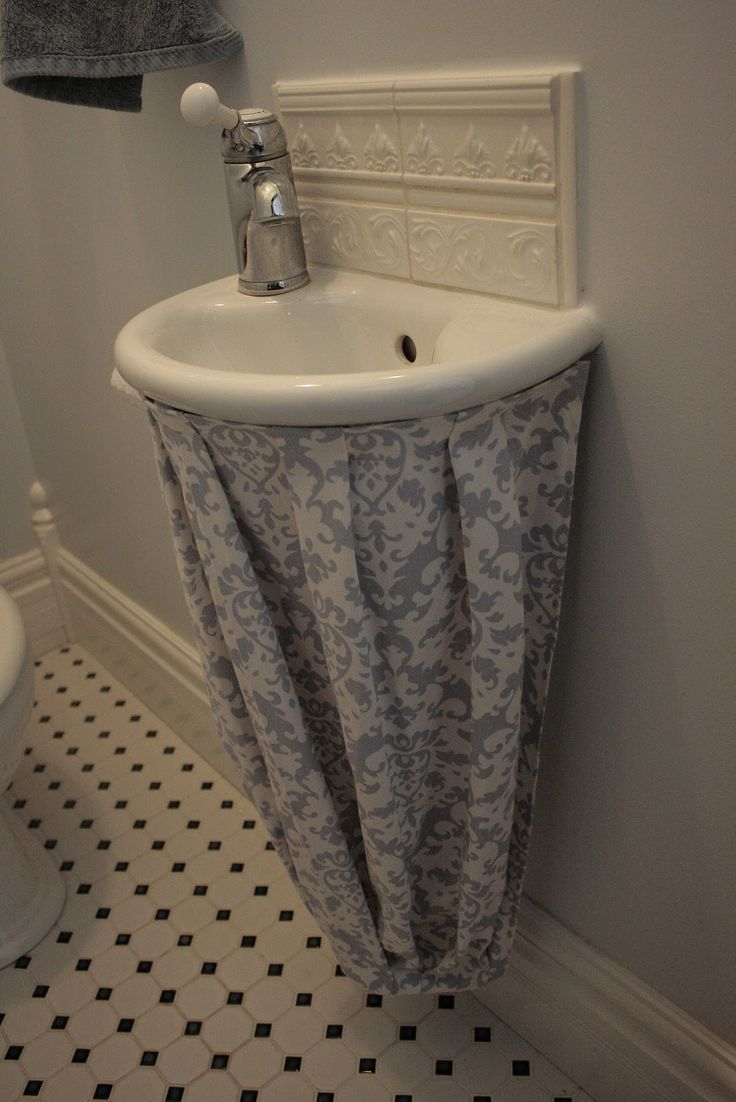 this is an interesting shape for a bathroom sink skirt (on the tiniest sink I've ever seen!)