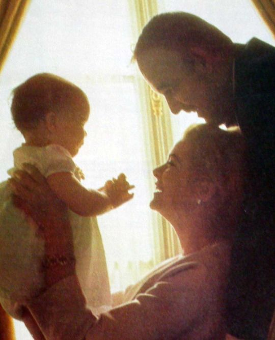 Baby Caroline with her Mommy and Daddy, 1957. – Howell Conant.