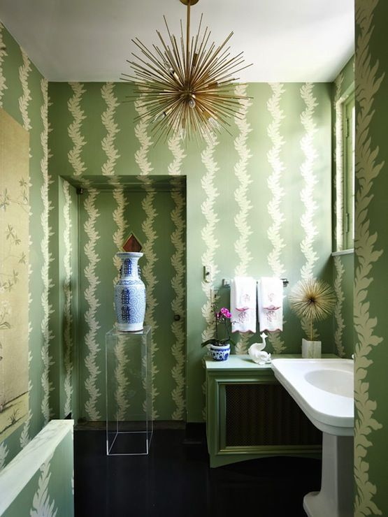 Farrow and Ball Acanthus Wallpaper paired with glossy black floors. Tonic  Home Zanadoo Chandelier.