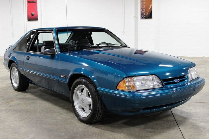 1993 Ford Mustang LX 5.0; my first Mustang. Mine was silver with red interior.