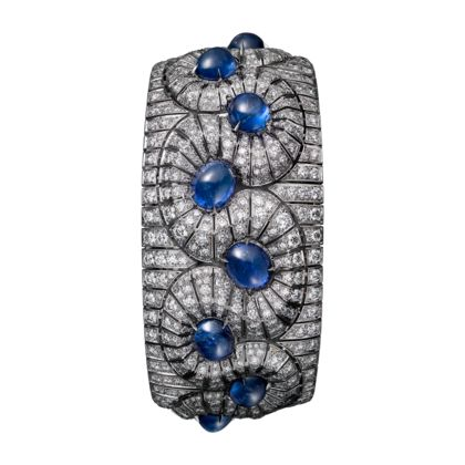 CARTIER BURMESE SAPPHIRE AND DIAMOND CUFF BRACELET~ - platinum, with twelve cabochon-cut sapphires totalling 35.44 carats, brilliant-cut diamonds.