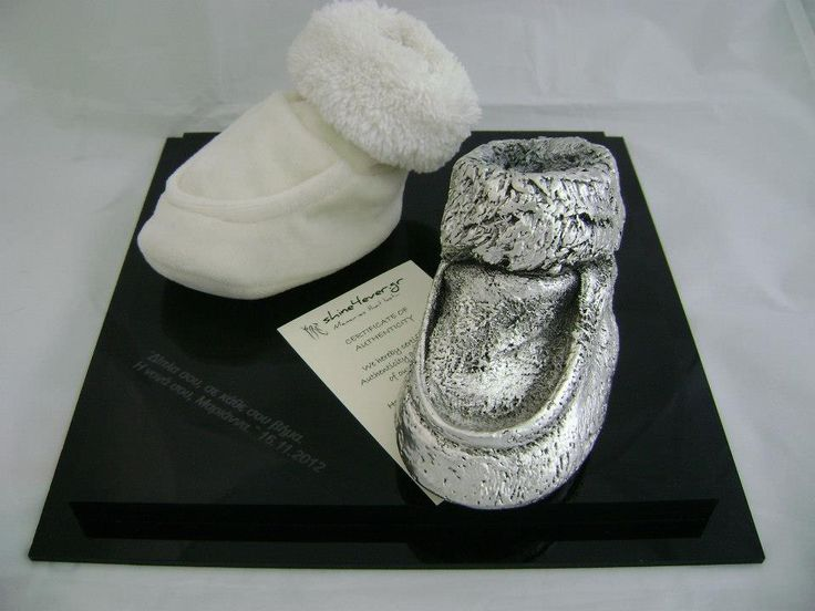 "The white tiny little shoes after we ""put on"" their new ""coat"" silver metal shoe! Your baby's first shoe...by Shine4ever.gr!"
