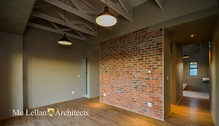 rough brick flush jointed interior wall whitewashed exposed trusses