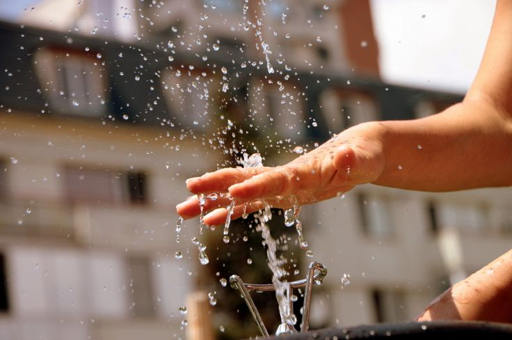 Water drops through the fingers of a girls, Water fountain, Summer Heat
