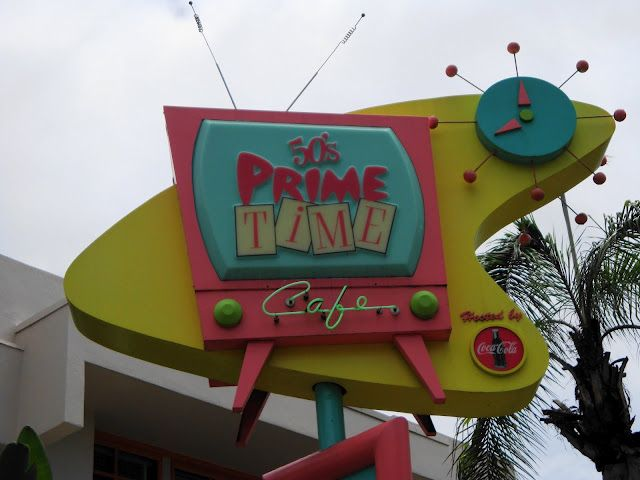 "50's Prime Time Cafe - Disney's Hollywood Studios may be the smallest of the theme parks, but it is home to one of the best-themed restaurants in all of Disney World. The 50's Prime Time Café is a nostalgic tour back to the 1950s, a time of classic television sitcoms such as ""I Love Lucy,"" and ""Leave It To Beaver."" In fact, a meal at 50's Prime Time makes you feel as though you have stepped right into one of these television shows. This is a restaurant where everyone is treated like family.50S Housewife, Prime Time, 50S Prime, Disney Parks, Time Cafes, Time Signs, Disney Hollywood Studios, 50 S Prime, Parties Signs"