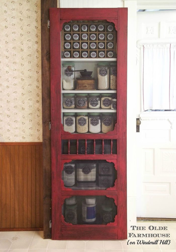 DIY Farmhouse Pantry - In giving my kitchen a makeover, I created this pantry in an unused wall space. 1x8 lumber, an old wooden screen door, thrift store canis�