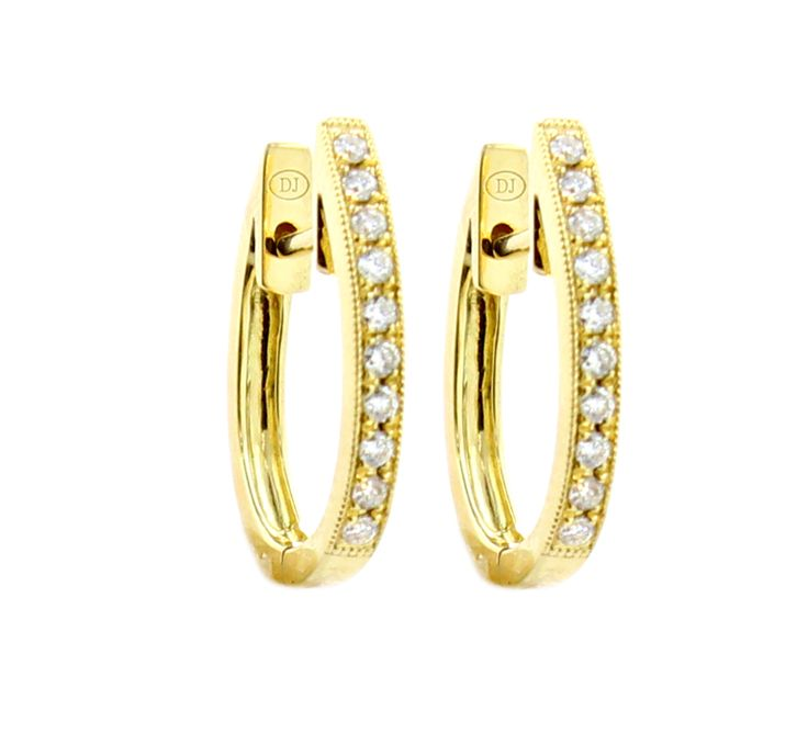 These eighteen karat yellow gold huggie earrings feature 016 carats of round brilliant white diamonds These are perfect to wear with our extensive collection of earring charms