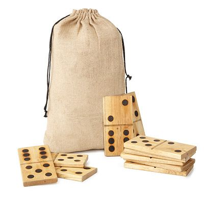UncommonGoods: Yard Dominoes. Bring the family together for some larger-than-life competition at the beach, at a picnic, or just at home with these oversized dominoes. Hand made from solid pine wood, each piece is sanded before the pips are hot iron branded into each side. Each set comes in a rustic drawstring bag and includes 28 dominoes, from double blanks to double sixes.