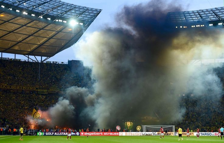 Borussia Dortmund fans burn Bayern jerseys in the stands.  Don't ever say Bundesliga supporters aren't committed!