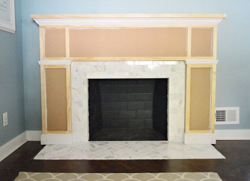 How we built out our fireplace with a wood surround (after tiling the hearth and some of the surround with marble subway tile).