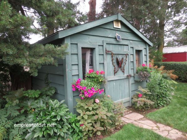 Gallery of best garden sheds - this blue shed is a fan favourite. Come get ideas for your garden.