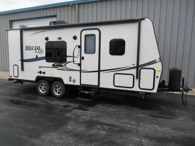 2016 New Forest River 23 FBKS Travel Trailer in Illinois IL.Recreational Vehicle, rv, 2016 Flagstaff Micro-Lite 23 FBKS. 23ft model travel trailer with 1 slide-out. Murphy bed feature makes for a great floor plan. Dry weight is 4,089lbs. Our price includes dealer freight, pre-delivery inspection, battery, filled propane bottles, starter kit and a full demonstration upon purchase.In addition to what is standard the trailer has the following options-CHERRY WOOD-HARBOR INTERIOR-SAPHIRE…
