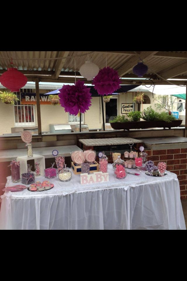 Pink and purple baby shower candy buffet