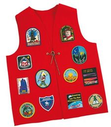 http://thethinkingmother.blogspot.com/2006/09/cub-scout-uniform-guide-patch.html Where to put patches and what to do with the cub scout red vest.