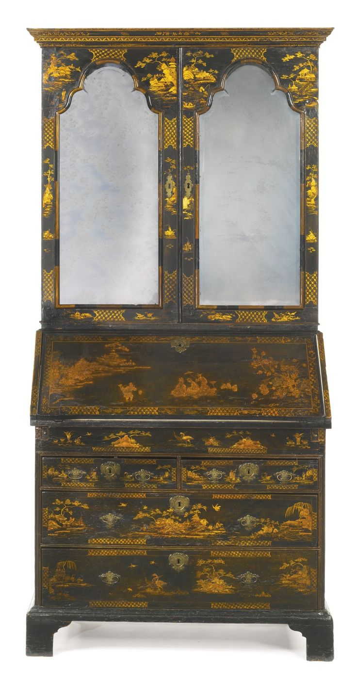 A Queen Anne parcel-gilt black-japanned desk-and-bookcase, circa 1710, upper section with a flat molded cornice above a pair of cupboard doors fitted with an arched bevelled mirror plate & opening to two adjustable shelves above a level of pigeon holes & banks of scallop-fronted drawers, lower section fitted with a slant-front opening to a writing surface before a sliding panel & valanced pigeon holes above small drawers... raised on bracket feet.  H 7 ft. 1 in.; W 42 1/2 in.; D 23 in.
