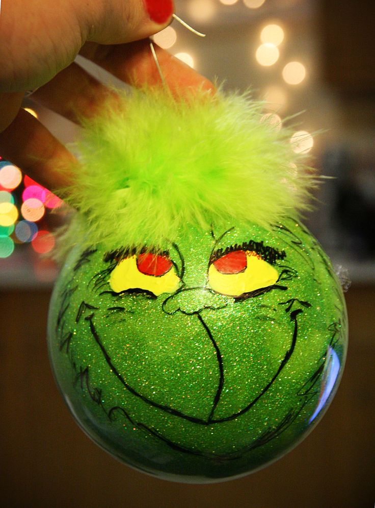 DIY Grinch ornament :)   Make this with a mixture of Pledge Floor Care Finish & glitter poured inside of the clear ornament! The eyes and everything else were painted on the outside. The hair on top was just some feather garland from Michael's.
