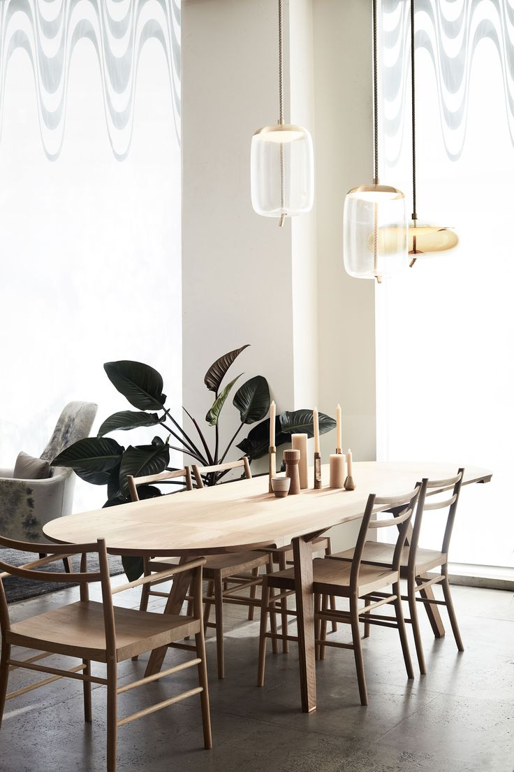 A relaxed dining setting with, STUDIOILSE Together Fixed Table, Avery chair's by PINCH and BROKIS Knot Pendant lights