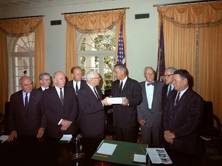 Earl Warren and members of the Warren Commission present report to LBJ